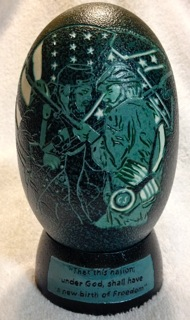 """Brother Against Brother"" - An Emu egg carved by Katy Wilson"
